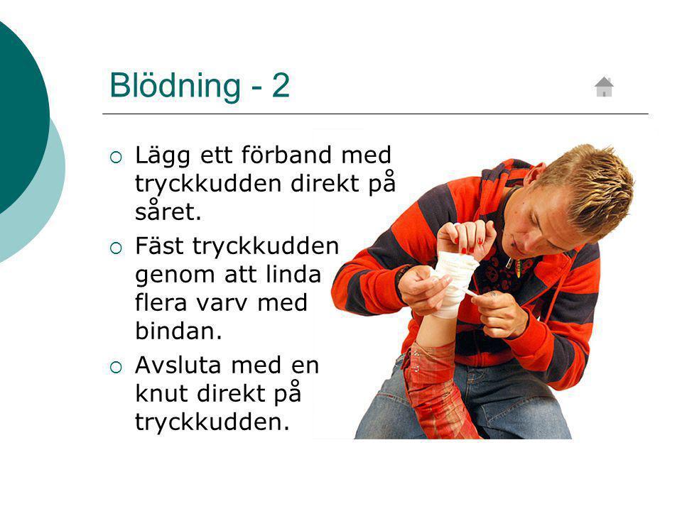 Blödning - 2 Lägg ett förband med tryckkudden direkt på såret.