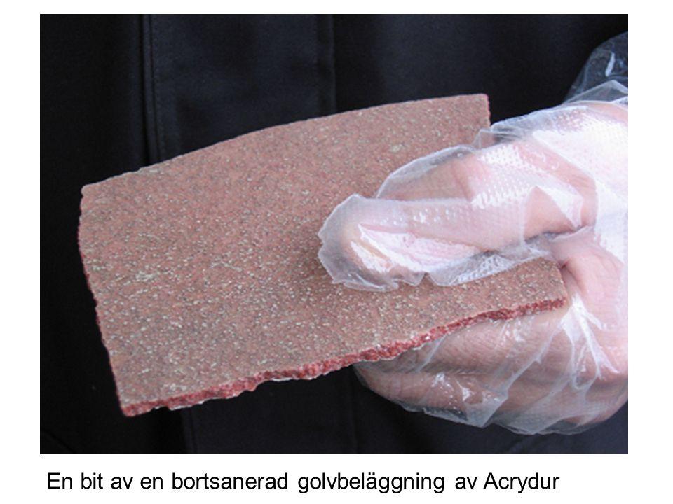 Exempel på golvmassa En bit av en bortsanerad golvbeläggning av Acrydur