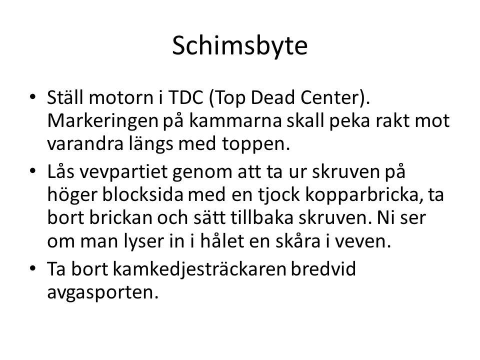 Schimsbyte Ställ motorn i TDC (Top Dead Center). Markeringen på kammarna skall peka rakt mot varandra längs med toppen.