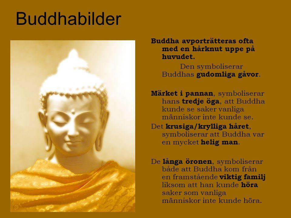 Buddhabilder Statyer av Buddha inkluderar många symboler.
